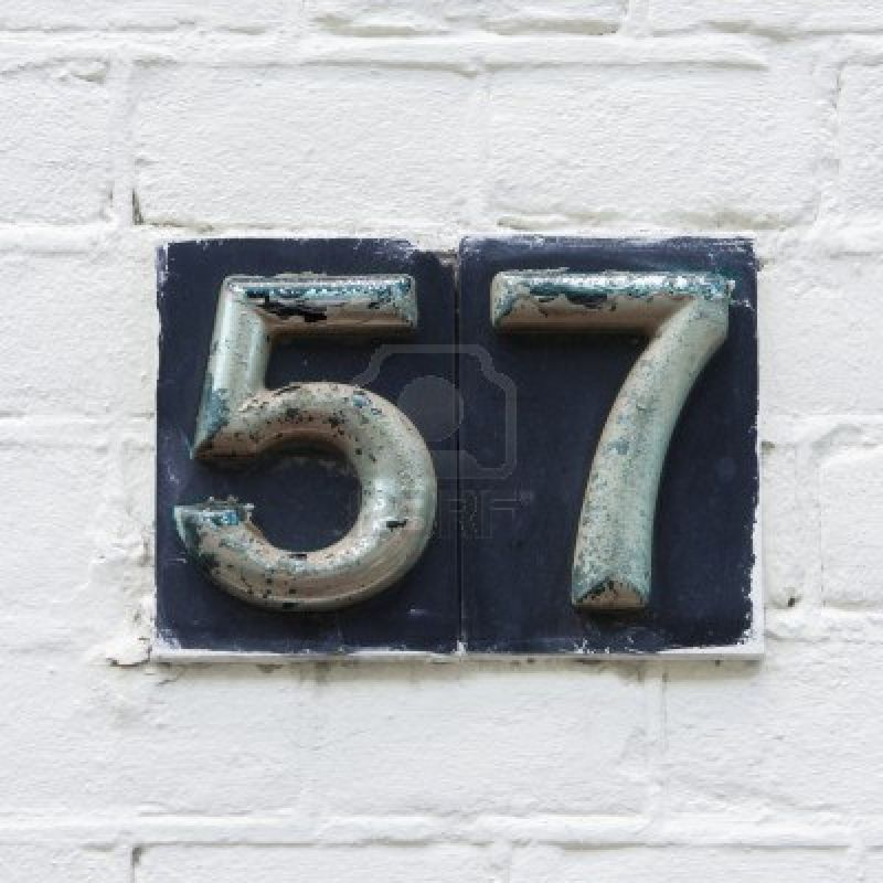 13972849-metal-beveled-house-number-fifty-seven-painted-over-and-flaking